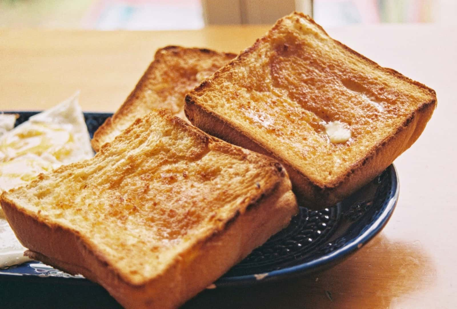 Buttered toasted white bread